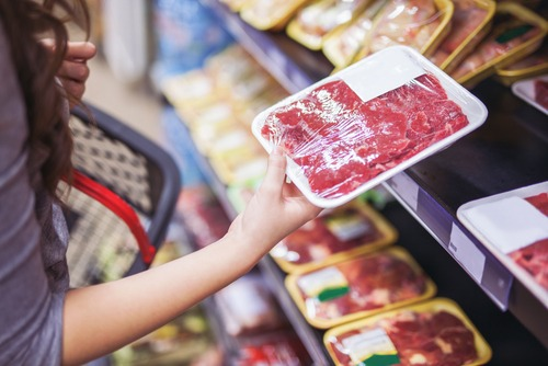 Close,Up,Of,Woman,Holding,Wrapped,Meat,In,Grocery,Store